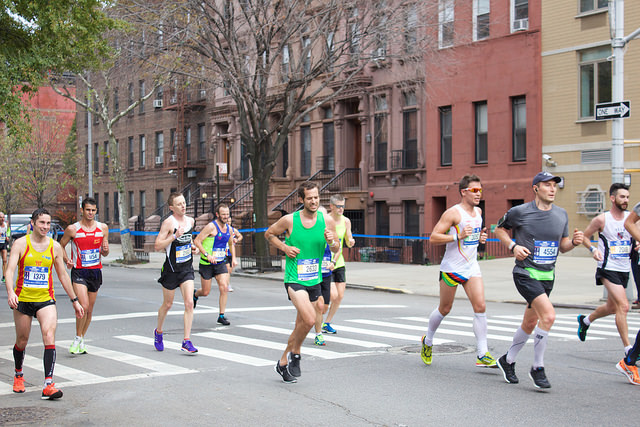 The New York City Marathon runners pushed through Harlem as they came to mile twenty-three with only three miles separating them from the finish line. By Astrid Hacker