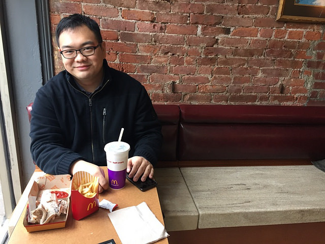 Edward Zhang, from Secaucus, NJ, was all smiles after finishing up a Double Quarter Pounder at a McDonald's in the East Village. Photo By Leann Garofolo