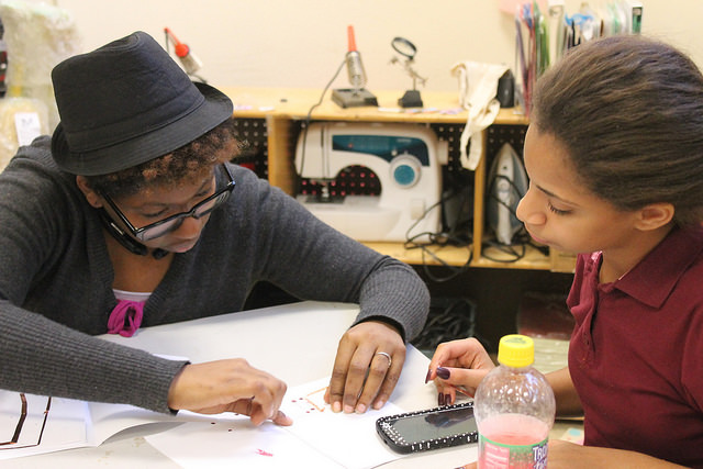 Laira Reid helps Kaylee Torres, 11, with a project at NYC Sparx in the South Bronx Photo by Karis Rogerson