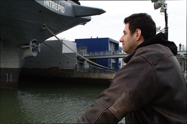 Michael Abramovich an Iraq War veteran, looks out into the harbor by the Intrepid Museum, as he recounts the obstacles he's faces as a veteran. Photo by Alexandra Zuccaro