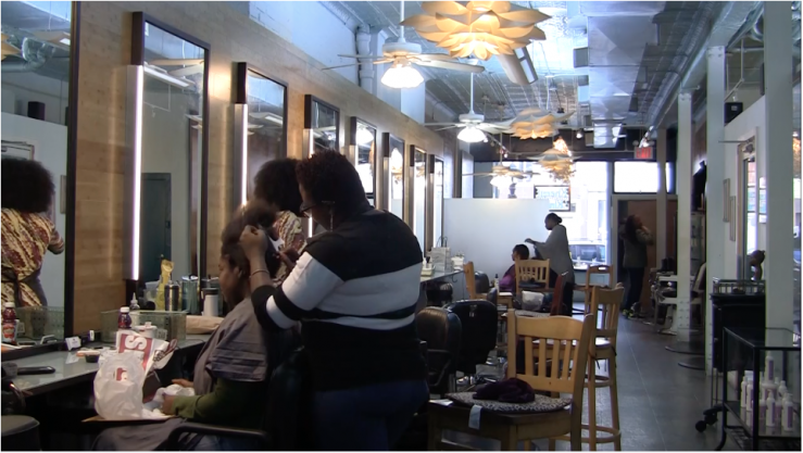 Women skip the harmful hair relaxers and opt for a natural look at Khamit Kinks Salon in Boerum Hills, Brooklyn.