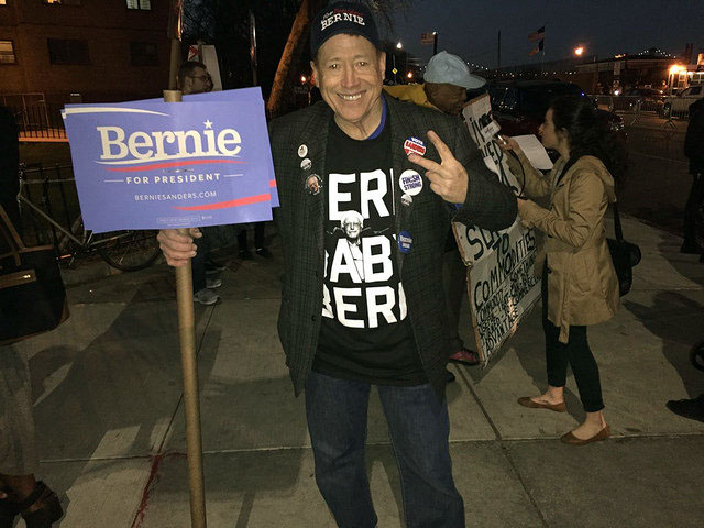 Kyle Cranston, of South Hampton in Long Island, New York, was decked out in Sanders attire outside of the debate venue. by Leann Garofolo