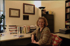 Dr. Caryn Medved sits in her office at Baruch College and explains her recent studies on stay-at-home fathers. Photo by Alex Zuccaro