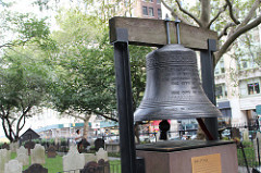 The Bell of Hope, which stands in the courtyard of St. Paul's Chapel, is rung on the anniversary of 9/11 each year to honor victims of the attack. The bell was given to the chapel by the Mayor of London and the Archbishop of Canterbury in September 2002. By Razi Syed.