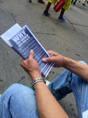 Claudio Marty displays a copy of the hundreds of pamphlets he gave out today. Photo by Eli Kurland