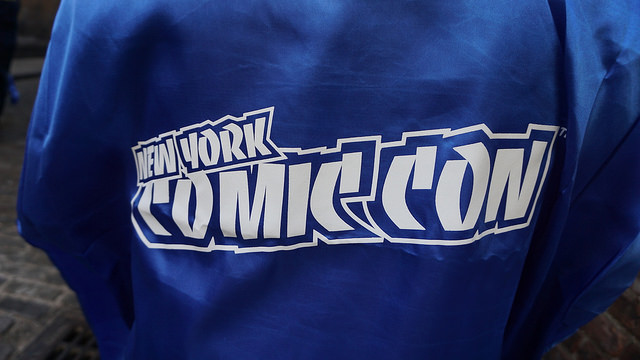 A fans wore a complimentary blue capes to celebrate New York Comic Con and Batman Day. Fans lined up at Midtown Comics hours before Batman writers and creators Frank Miller, Scott Snyder, Greg Capullo and Tom King showed up yesterday .Photo by: Sophie Herbut