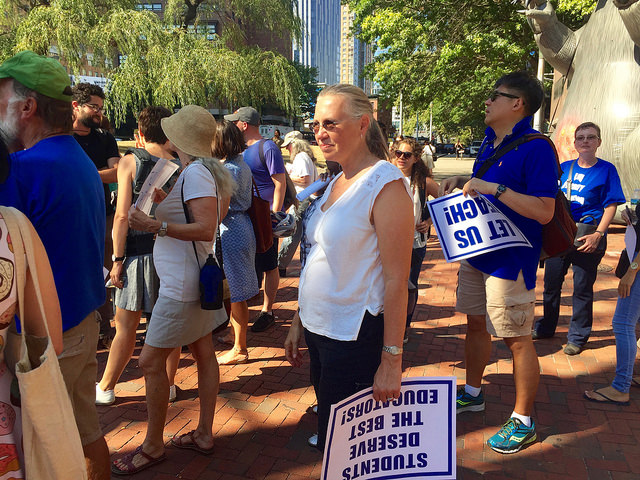 Rebecca States, professor of Physical Therapy and President of the Faculty Senate protested outside the campus gates on Wednesday. Her and her fellow 400 faculty members were not allowed inside Photo by Eli kurland.