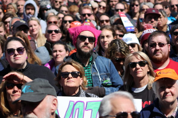 The crowd, including a man wearing a pussy hat, listen to speakers at March for Our Lives in Washington, D.C.