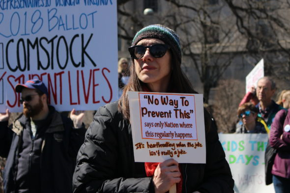 "A protester holds up a sign that says ""No way to prevent this, says the only nation where this regularly happens"" at March for Our Lives in Washington, D.C."