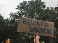 Protesters highlighted the importance of believing women as they gathered in Washington Square Park prior to Brett Kavanaugh's confirmation to the Supreme Court. Photo by Kerry Breen.
